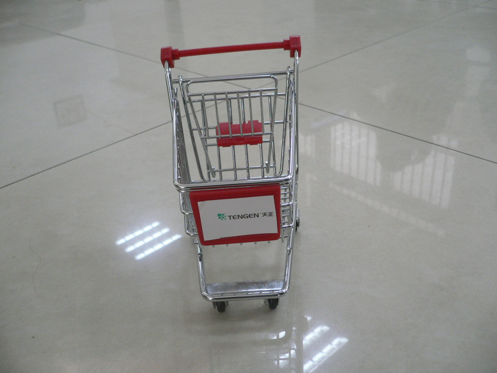 Mini shopping cart trolley with company sticker with plastic advertising board